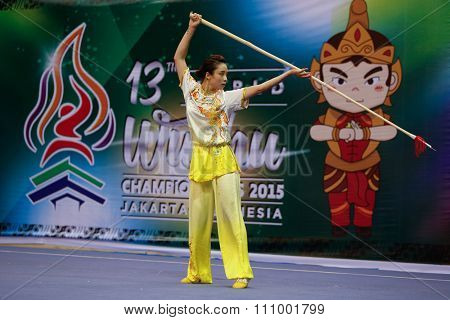 JAKARTA, INDONESIA - NOVEMBER 15, 2015: Thuy Vi Duong of Vietnam performs the movements in the women's Qiangshu (spear) event at the 13th World Wushu Championship 2015 held in Istora Senayan, Jakarta.