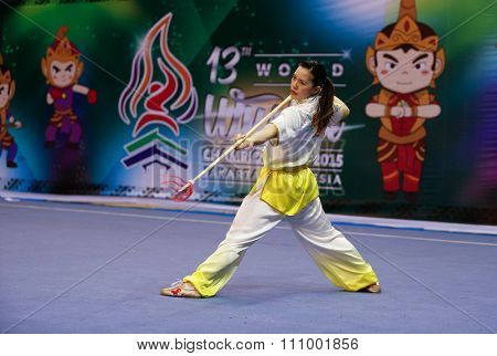 JAKARTA, INDONESIA - NOVEMBER 15, 2015: Stephanie Lim of the USA performs the movements in the women's Qiangshu (spear) event at the 13th World Wushu Championship 2015 held in Istora Senayan, Jakarta.