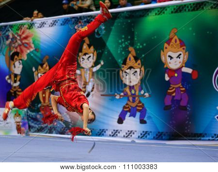 JAKARTA, INDONESIA - NOVEMBER 15, 2015: Canada's Winnie Cai performs in the Women's Shuangjian event at the 13th World Wushu Championship 2015 held in Istora Senayan, Jakarta.