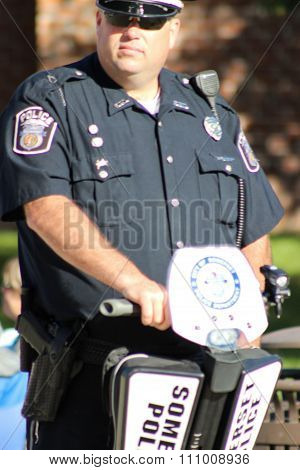 Police Officer Rides a Segway