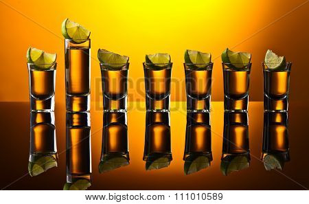 Gold Tequila On Reflective Background