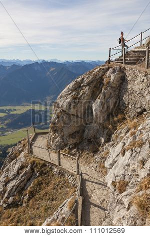 Young Woman On Winding Hiking Trail At Wendelstein Mountain