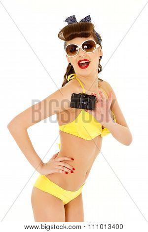 Girl In Bikini With Retro Camera.