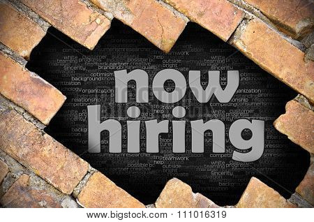 Hole In The Brick Wall With Word Now Hiring