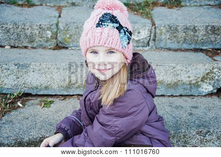 Little Cute Girl Sitting On  Stairs In The Park