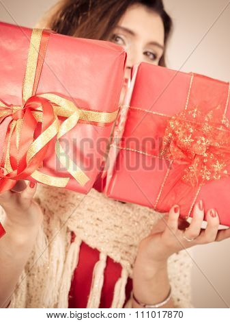 Woman With Red Gift Boxes Closeup.