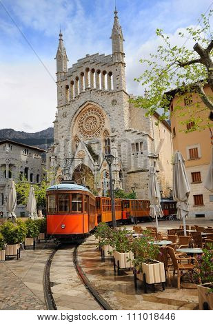 Old Tram In Front Of The Cathedral Of Soller, Mallorca, Spain