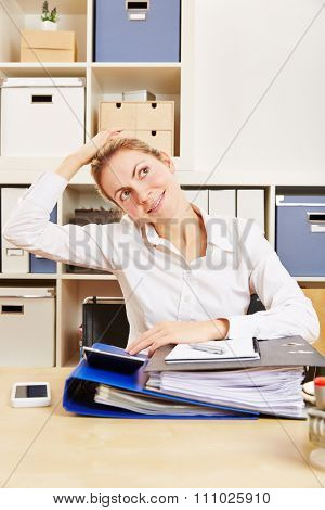 Young business woman in office stretching her tense nape with her hand