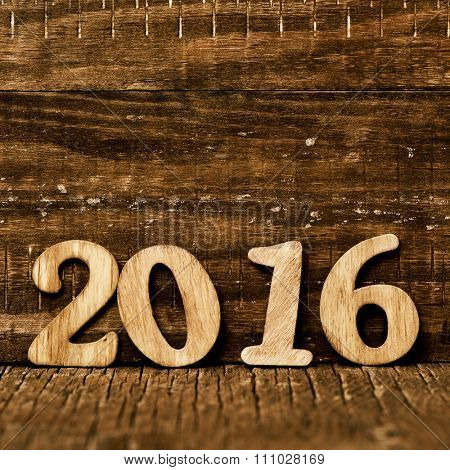 wooden numbers forming the number 2016, as the new year, on a rustic wooden surface