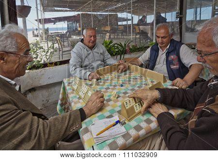 Turkish Men Playing Rummy Tile Game Near The Seaside