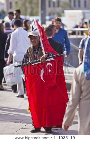 Street Vendor Near Istanbul Spice Market With Turkish Flags