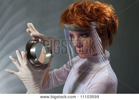 Futuristic Woman Examine Metal Detail