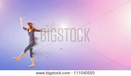 Excited Asian woman dancing with copyspace.