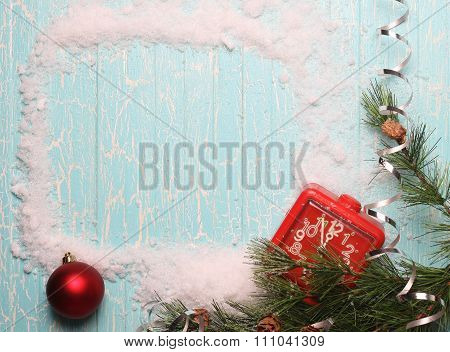 Frame With Snow, Fir Branches, Alarm Clock On An Old Wooden Board Painted