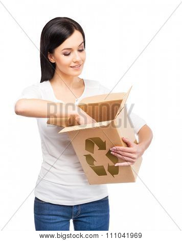 Save the planet concept. Girl holding paper box with recycle symbol on it.