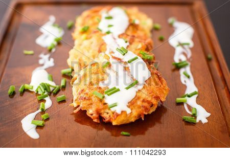 Fried Potato Pancakes With Sour Cream And Green Onions
