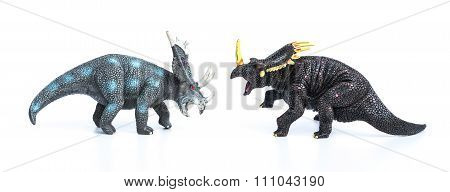 Styracosaurus And Triceratops Toys On A White Background