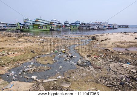 Polluted Shore Of Rio Negro In Manaus