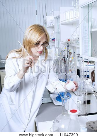 Woman Scientist With Laboratory Pipettes