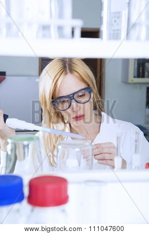 Woman Scientist With Laboratory Pipette