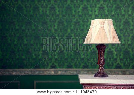 Vintage Lamp On Green Pattern Background On Chimney