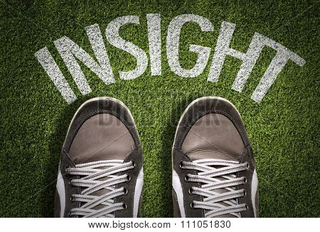Top View of Sneakers on the grass with the text: Insight
