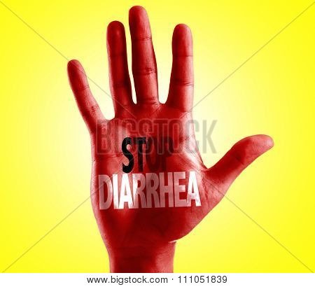 Stop Diarrhea written on hand with yellow background