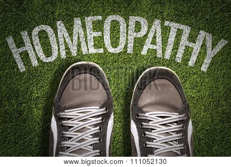Top View of Sneakers on the grass with the text: Homeopathy