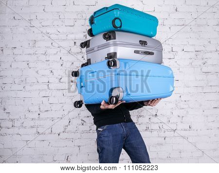 The Man With The Suitcases