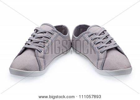 A Pair Of Gray Gumshoes With Shoelace