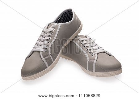 A Pair Of Grey Sports Shoes With Shoelace