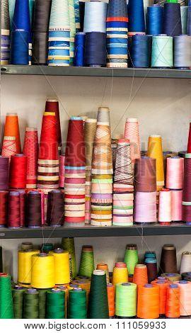 Colorful Cotton Thread Spools On Shelf