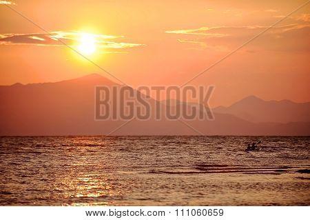 People Kayaking On The Shkodra Lake At Sunset
