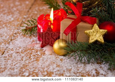 Christmas gift on wooden table , christmas tree, red candle .