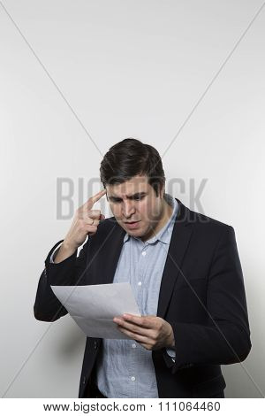 angry businessman reading a paper