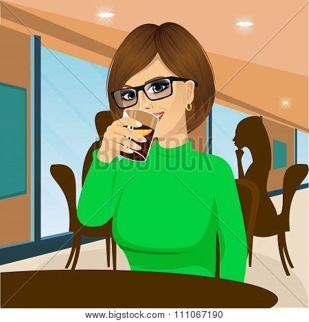 young woman with glasses drinking beverage