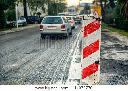 Road Works Marked With Red And White Striped Road Warning Post
