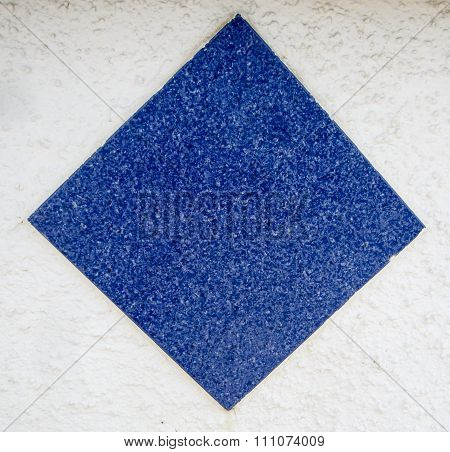 blue stone square on rough white background