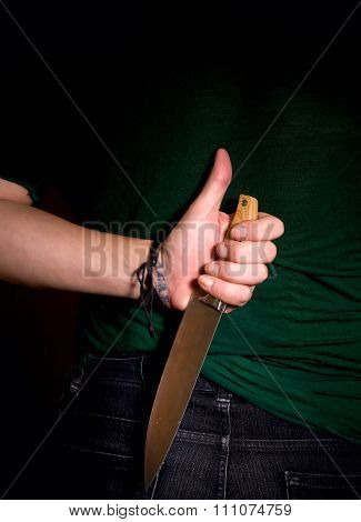 Hand With Knife Behind His Back