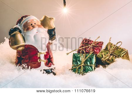 Santa claus hold the bell and star and light bulb stand in silent night, light up the hopefulness an