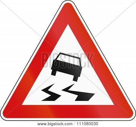 Slovenian Road Warning Sign - Slip Danger