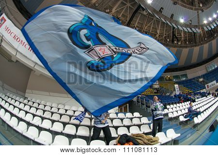 MOSCOW -- DECEMBER 4, 2014:  Unrecognized fans of the club Dynamo on the International Europe bascketball league match Dynamo Moscow vs Maccabi Ashdod Israel in sport palace Krilatskoe, Moscow, Russia. Dynamo loss 59:67