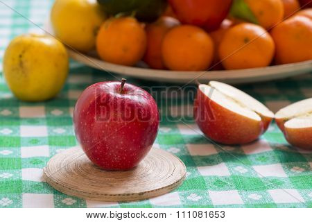 Fresh Gala Apple On A Table With Fruit Basket In Background