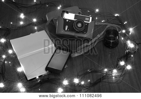 the old camera on a table with New Year's fires