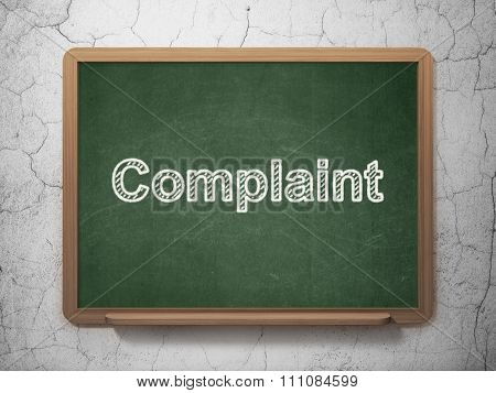 Law concept: Complaint on chalkboard background