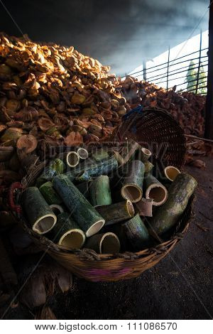Glutinous rice roasted in bamboo joints in factory.