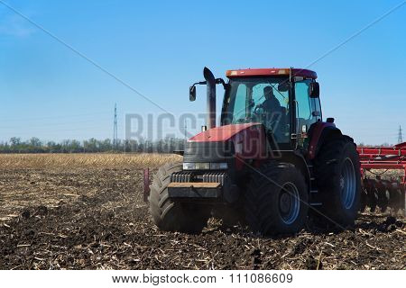 Red Tractor Working In The Field