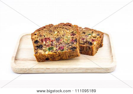 Close Up Fruit Cakes In Wooden Dish On White Background
