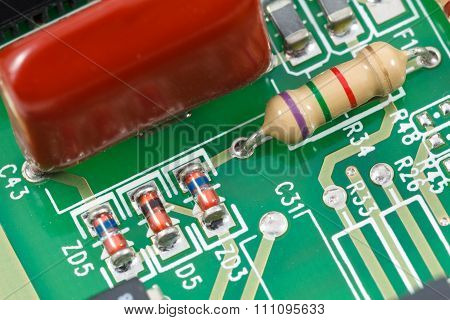 Macro Shot Of Printed Circuit Board (pcb) With Resistors, Diodes And Capacitors