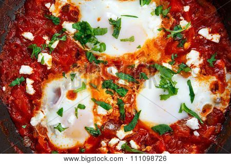 Fresh Eggs Poached In Tomato Sauce And Red, Yellow Pepper, Onion